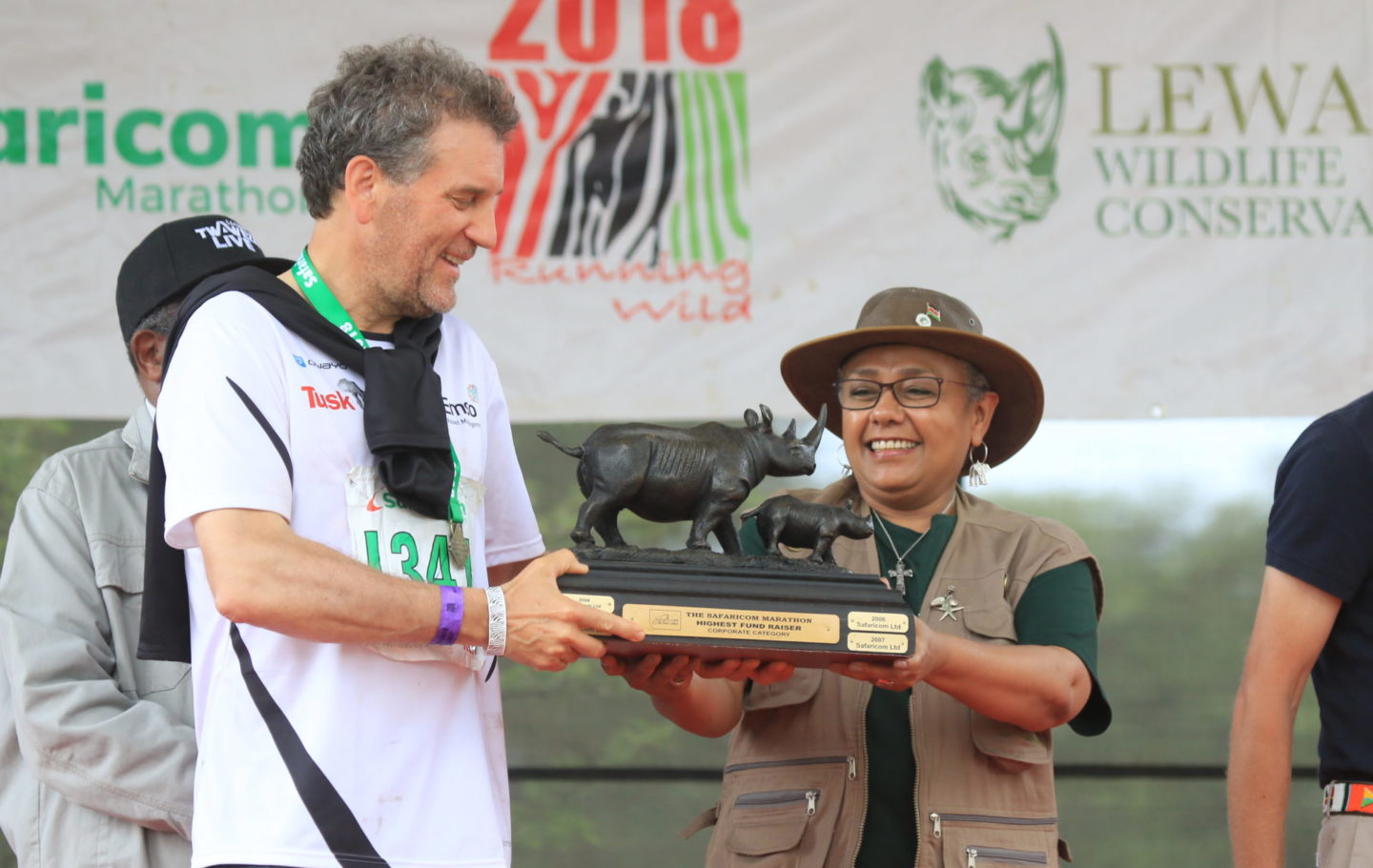 Mark Franklin of Emso is presented the fundraising trophy by Kenya's First Lady