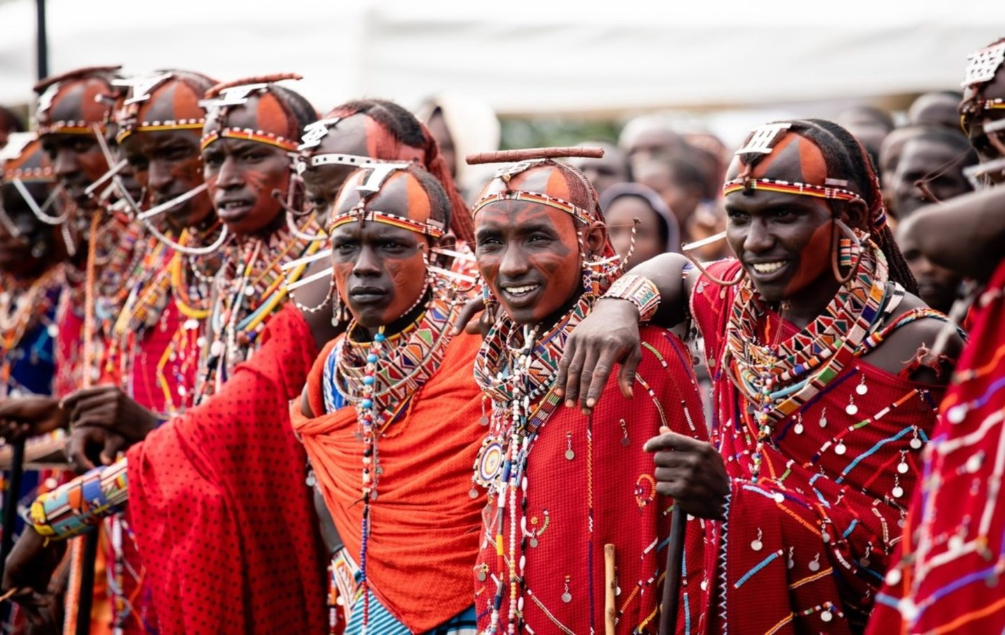 Image One of the warrior teams watches the prize-giving ceremony at the Maasai Olympics finals