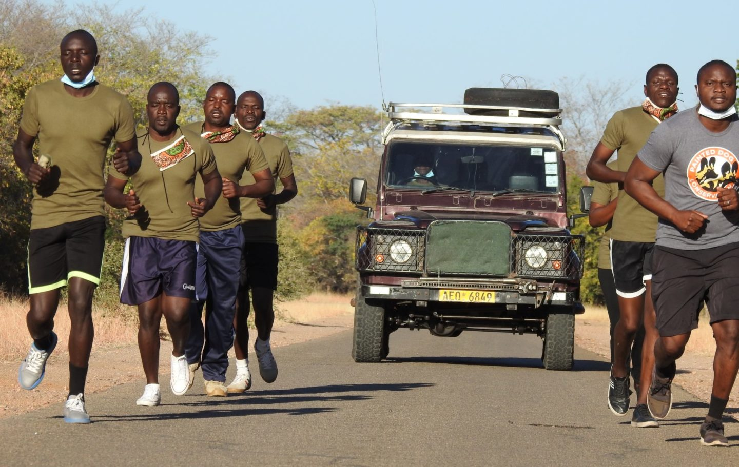 Rangers from Painted Dog Conservation running in Zimbabwe