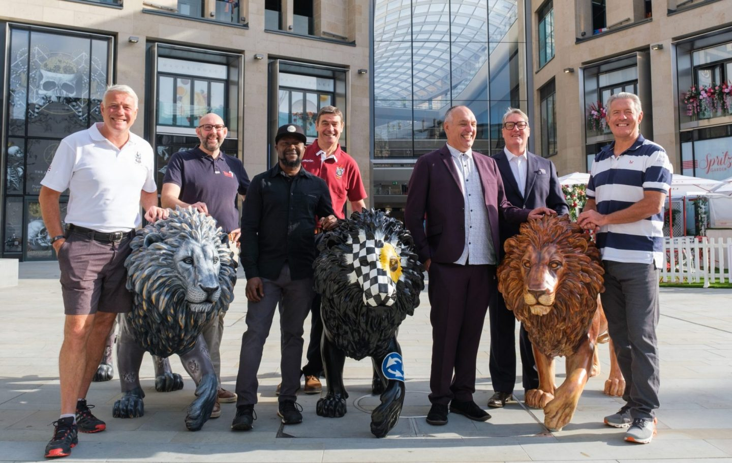 At Edinburgh's St James's Quarter three lions were welcomed by (L-R) rugby's Scott Hastings, Tusk's Dan Bucknell, artist Ade Adesina, rugby's Euan Kennedy, artist Adrian Wiszniewski, St James's Quarter's Nick Peel and rugby's Gavin Hastings